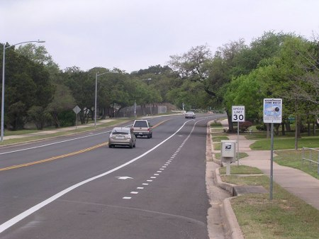A typical arterial street that moves traffic through Circle C Ranch. Note the generous bike lane.
