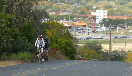 The first riders approach the crest of the hill. Yeah, it's steep.