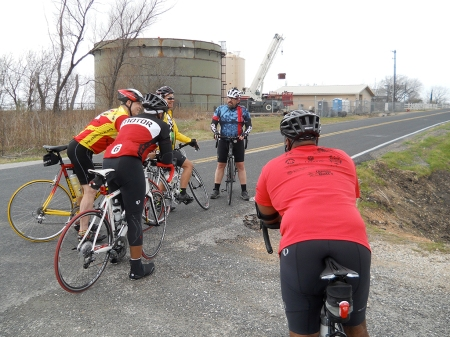 The guys wait for Amy, who had stopped to take a phone call. That's a water supply facility in the background.